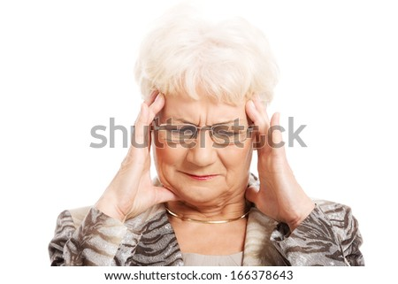 An old elegant lady is having a headache. Isolated on white.