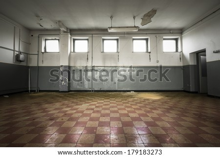 An old empty room, checkered tile floor