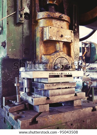An old factory interior and an obsolete heavy machinery for metal works - stock photo