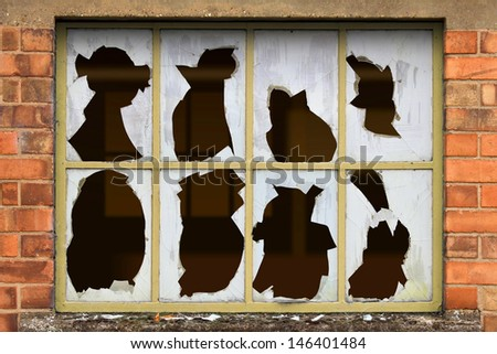 An Old Factory Window with Broken Glass - stock photo