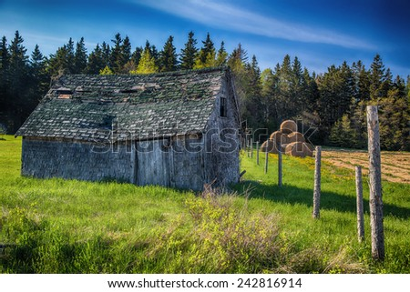 An old farm building in rural Prince Edward Island, Canada.  - stock photo