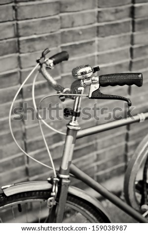 An old-fashioned blue vintage bike handlebars - with droplets