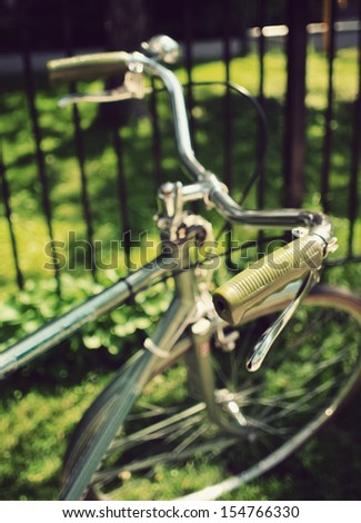 An old-fashioned green vintage bike handlebars - stock photo