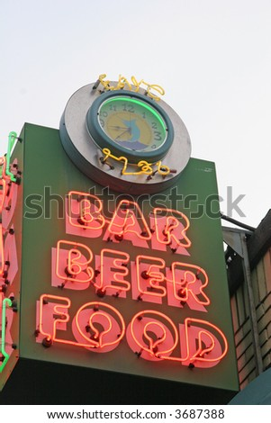 An old fashioned neon sign at a bar - stock photo