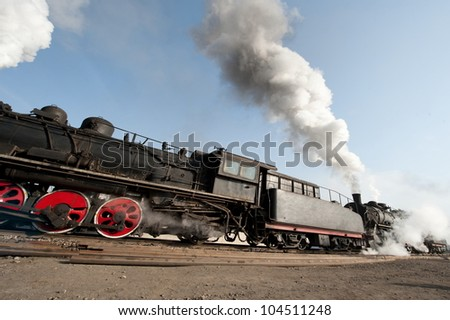 An Old Fashioned Steam Engine and Train.