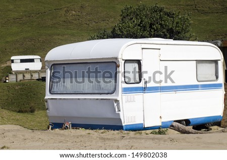 An old fashioned trailer caravan in caravans campsite.