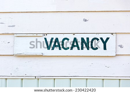 An old fashioned vacancy sign on an old motel.