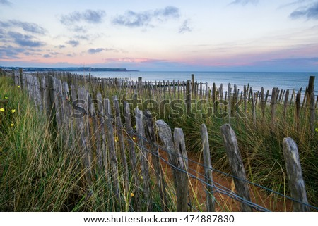 An old fence on a coastal path at Dawlish Warren Devon