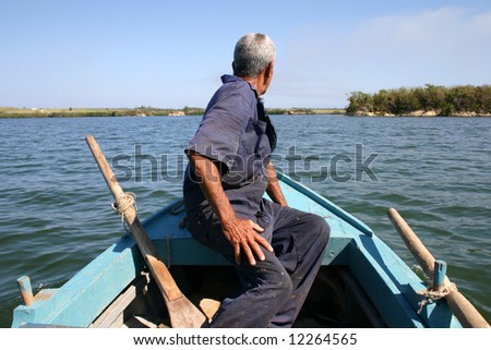 An old fisherman in Mariel Bay, Cuba - stock photo