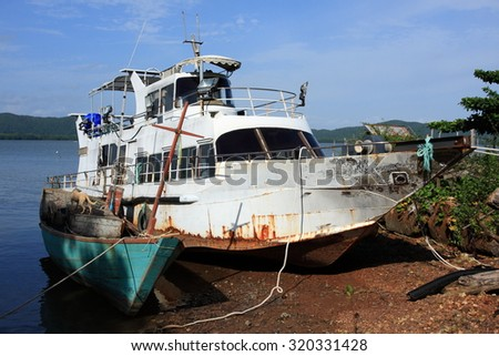 an old fishing boat - stock photo