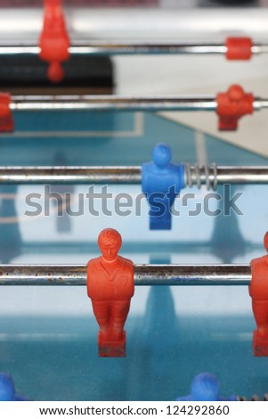 An old football table. Shallow depth of field, soft focus - stock photo
