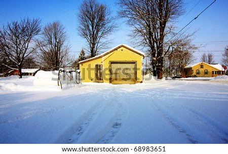 an old gas station on a winter day - stock photo