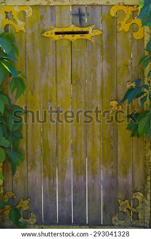 an old gate with mailbox and ornaments - stock photo
