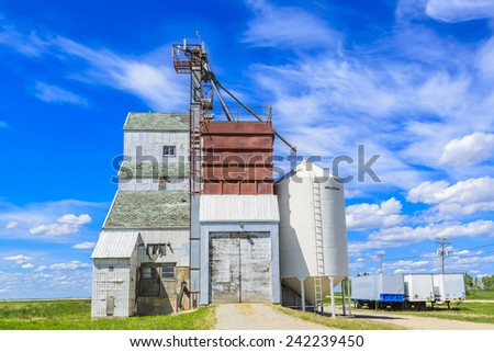 An old grain elevator has been converted into a seed farm.  Farmers grow seeds for sale or for farm use. - stock photo