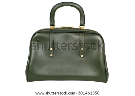 an old green leatherette purse on a white background