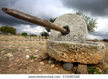 An old grinding stone at Palaepaphos, Sanctuary of Aphrodite near Paphos in Cyprus - stock photo