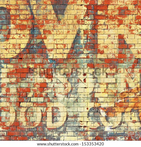 An Old Grunge Red Brick Wall with Painted Letters - stock photo