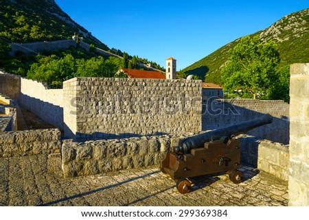 An old gun on the old walls in the village of Ston, in Dalmatia, Croatia - stock photo