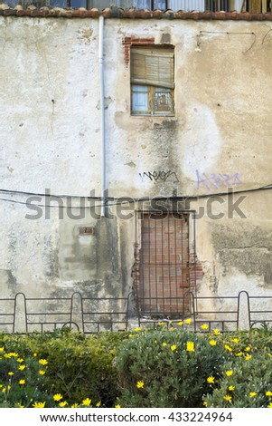 An old house next to railway in the city of Calella, Catalonia - stock photo