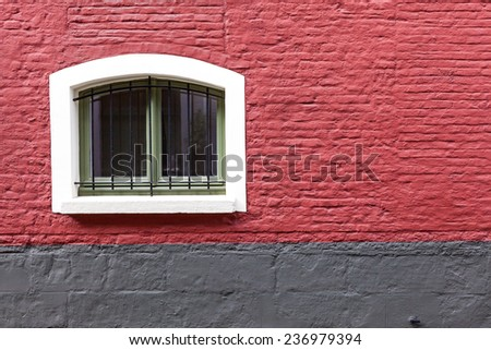 an old house whit an old window - stock photo