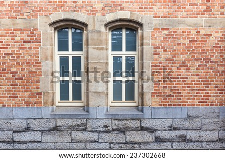 an old house whit an two old windows - stock photo