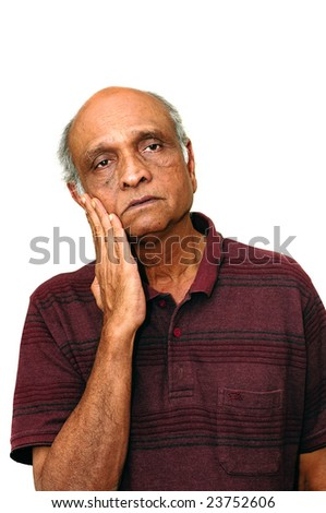 An old Indian immigration looking sad with a pain - stock photo