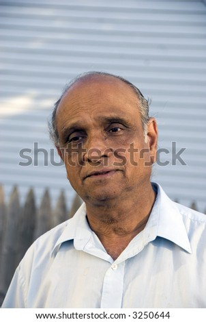 An old indian man smiling in the summer sun