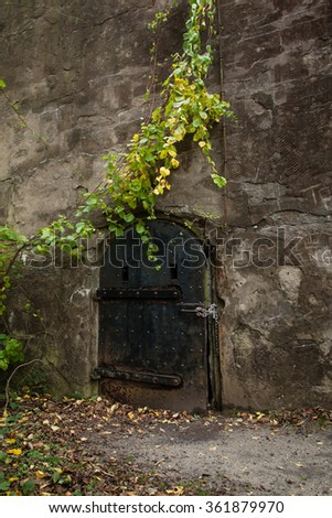 An old iron door at an old military base - stock photo