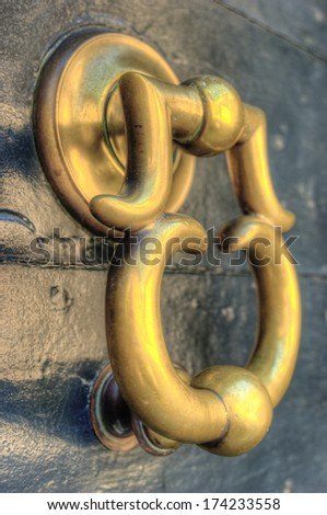 An old italian brass door knocker found in Northern Italy whilst on holiday - stock photo