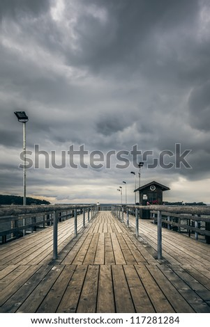 An old jetty at Chiemsee lake in Bavaria Germany - stock photo