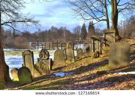 an old jewish cemestery on a hill in the park of Chodov�¡r Plan�¡ in Czechia in East Europe