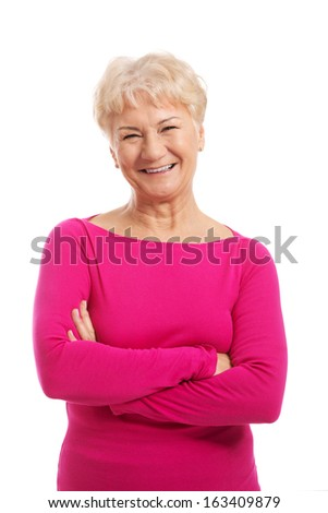 An old lady's portrait in pink casual clothes. On white background