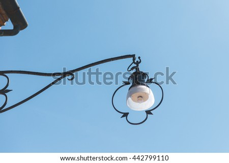 An old lantern on the street of the town - Burano, Venice, Italy, Europe  - stock photo
