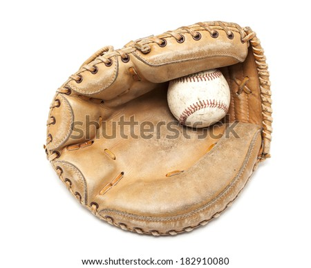 An old leather catchers mit and hardball on a white background. - stock photo