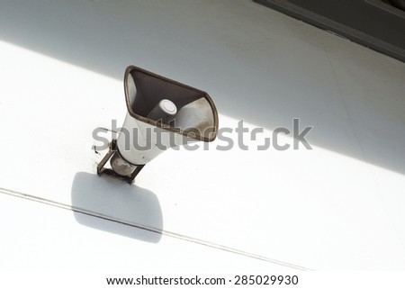 an old loudspeaker under the roof - stock photo