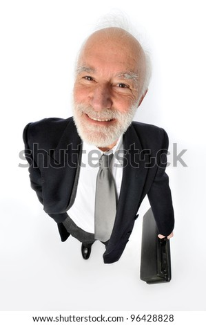 an old man holds a suitcase - stock photo
