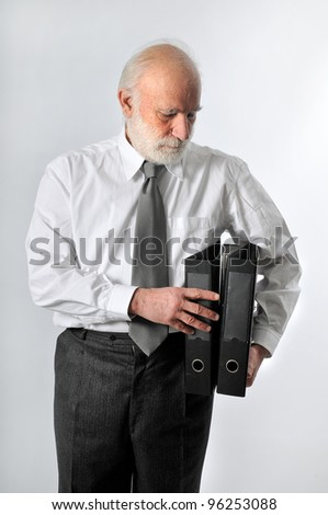 an old man keeps two black folders - stock photo