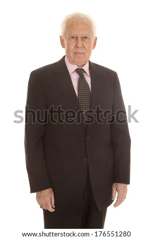 An old man standing in a suit and tie. - stock photo