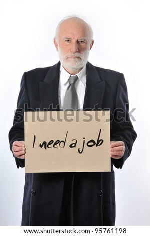 "an old man who keeps a paper sign ""I need a job"" - stock photo"