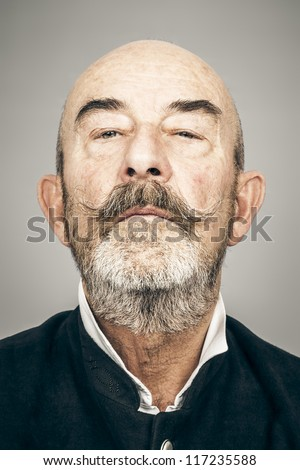 An old man with a grey beard - stock photo
