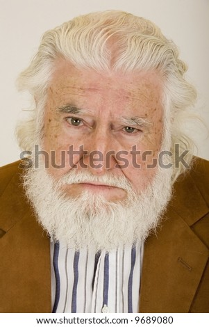 an old man with an unhappy face