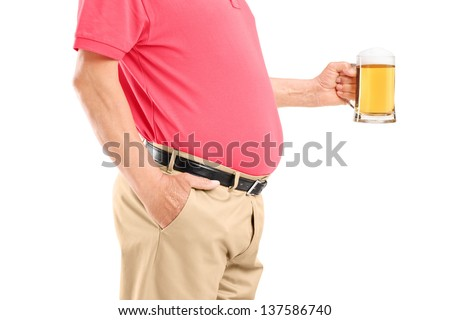 An old man with belly holding a beer glass isolated on white background - stock photo