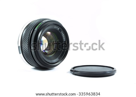 An old manual control camera lens isolated on white. - stock photo