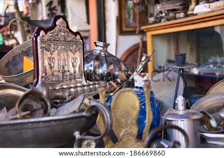 An old Menorah and other Jewdaica and artifacts in an antique store in Jaffa, Tel Aviv, Israel - stock photo