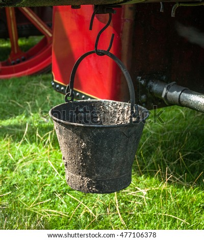 An old metal bucket for collecting ash from a steam engine.