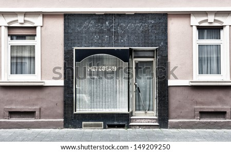 An old metzgerei (German for butcher's shop) that has long since closed. - stock photo