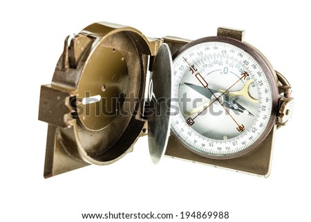 an old military chinese compass isolated over a white background - stock photo