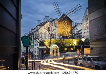 An old mill called Moulin de la Galette in Montmartre, the neighborhood in Paris, France. where famous painters like Picasso or Modigliani used to live. - stock photo