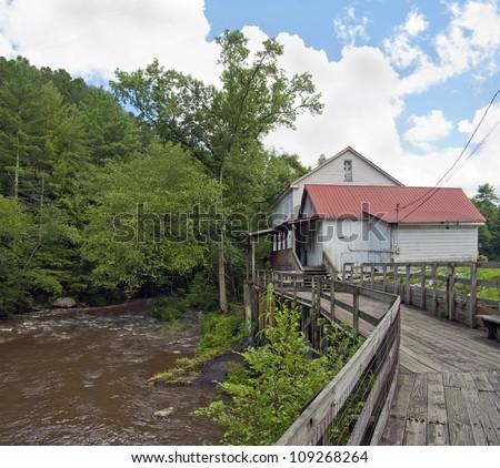An old mill on the Chattahoochee River near Helen, Georgia. - stock photo