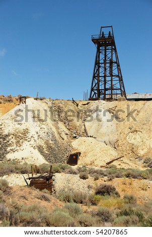 An old mine shaft entrance just south of Virginia City Nevada. - stock photo